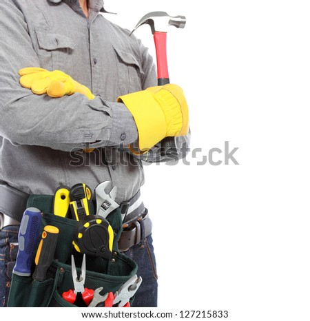 worker holding a hammer ready to work with full equipment - stock photo