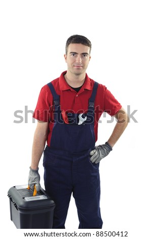 worker holding a toolbox isolated on white background - stock photo