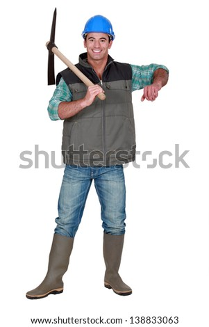 Worker holding ax - stock photo