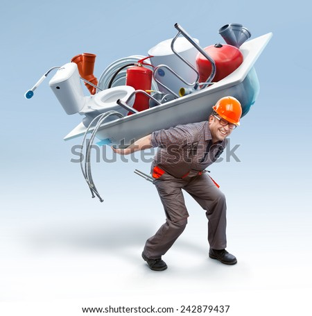 Worker holding bathtub with sanitary engineering on his back // showing big assortment - stock photo