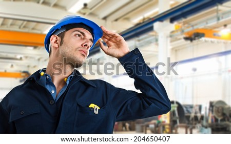 Worker holding his helmet - stock photo