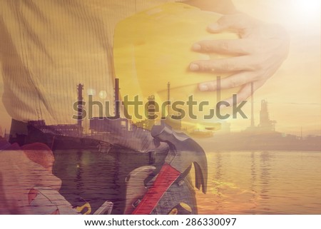 Worker holding tool with Twilight time on Labor Day  - stock photo