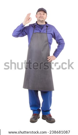 Worker in black apron with ok sign. Isolated on a white background. - stock photo