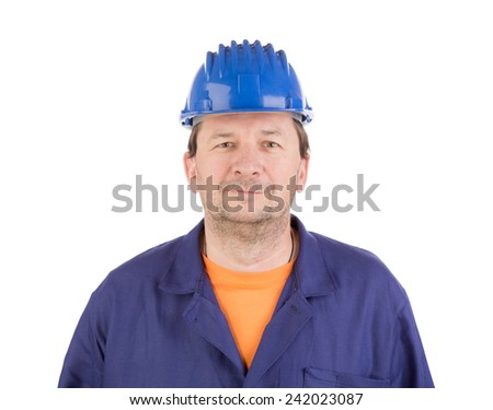 Worker in blue protective helmet. Isolated on a white background.  - stock photo
