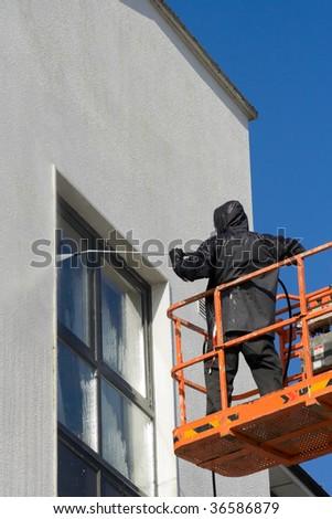 worker in cherry-piker - stock photo