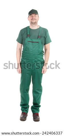 Worker in green overalls. Isolated on a white background.  - stock photo