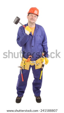 Worker in hard hat holds hammer. Isolated on a white background. - stock photo