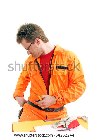 worker in orange overall searching tools on a belt, isolated on white - stock photo