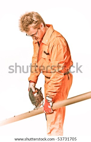 worker in overalls saws pipe with a jigsaw, isolated on white - stock photo