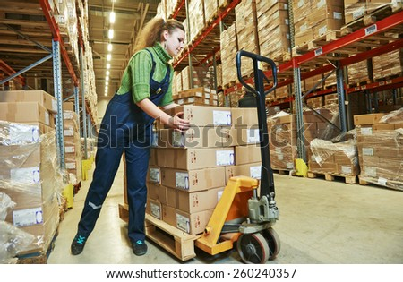 worker in warehouse with bar code scanner - stock photo