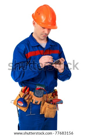 Worker in workwear with modern mobile phone against white - stock photo