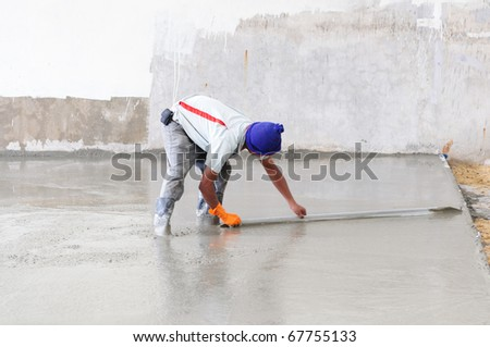 Worker leveling Concrete - stock photo
