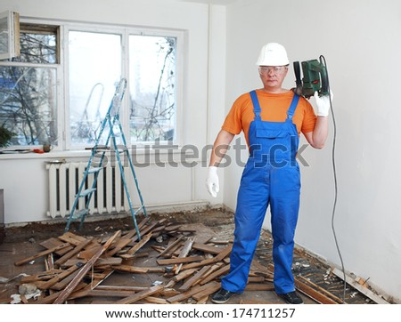 worker makes repairs in the apartment - stock photo