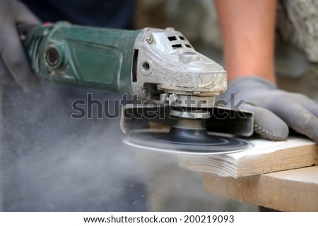 Worker polishing a wood table. Close-up - stock photo