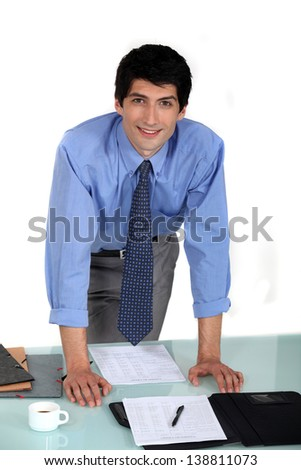 Worker stood by desk - stock photo