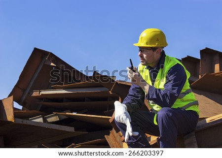 Worker use walkie-talkie to organize business. Copy space available. - stock photo