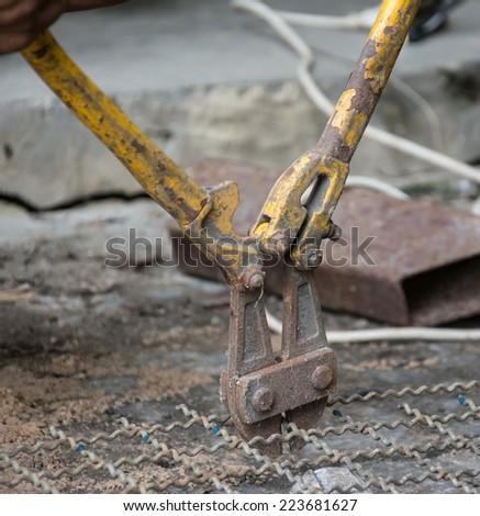 Worker used  Plier cut metal mesh - stock photo