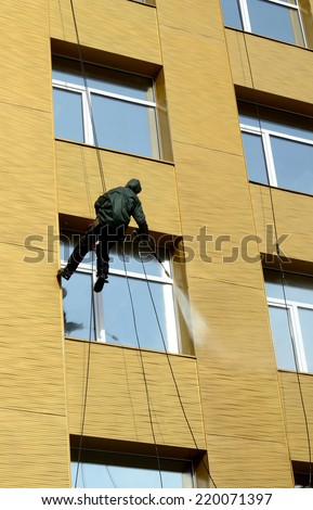 Worker washes windows  - stock photo