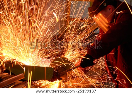 worker white hot sparks at grinding steel material - stock photo