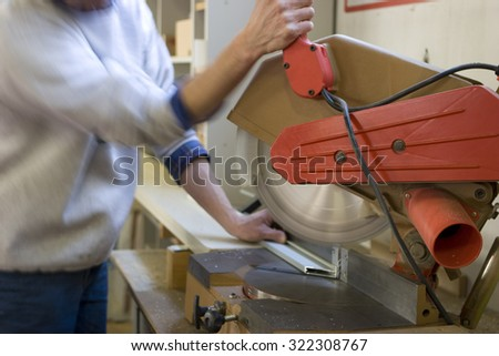 worker who is working with a rotary saw  - stock photo