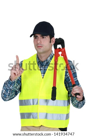 Worker with a pair of bolt cutters - stock photo