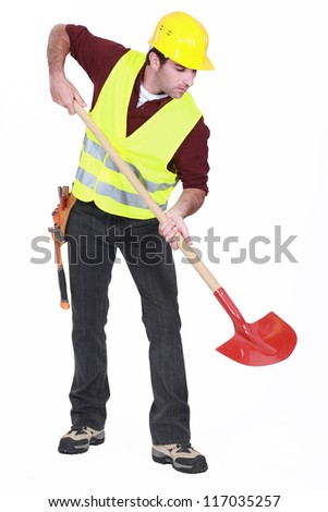 Worker with a shovel - stock photo