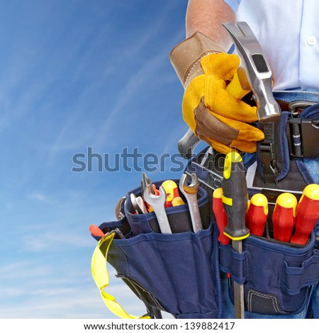 Worker with a tool belt. Construction and house renovation concept. - stock photo