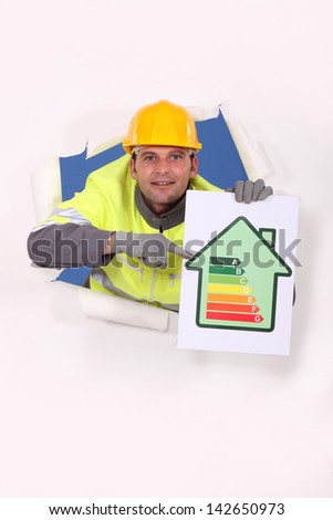 Worker with an energy rating sign - stock photo