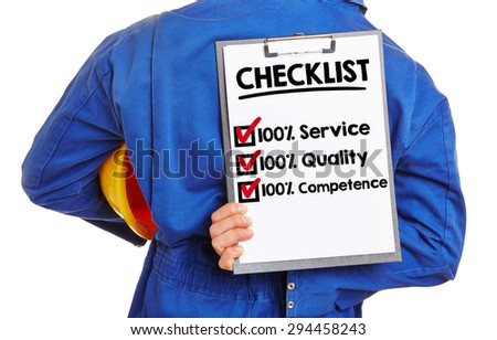 Worker with checklist for quality and service on a clipboard - stock photo