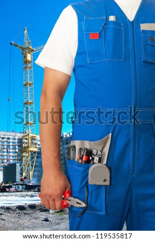 worker with equipment on building background sets - stock photo
