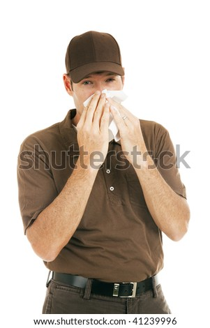 Worker with flu blowing his nose.  Isolated on white. - stock photo