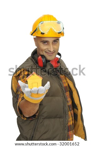 Worker with hat showing a little house in is hand isolated in white - stock photo