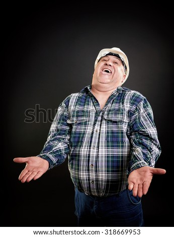 Worker with helmet laughing with open arms, perfect white teeth. Photo isolated on black background. - stock photo