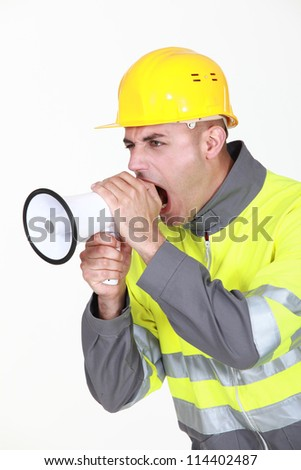 Worker with megaphone - stock photo