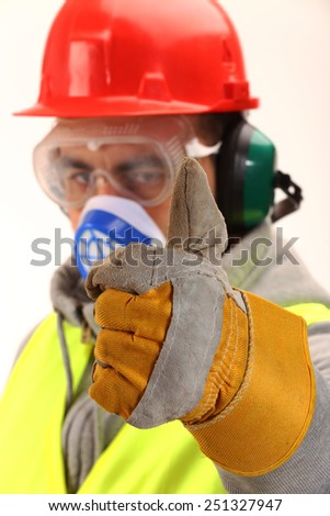 Worker with protective gear and thumbs up  - stock photo
