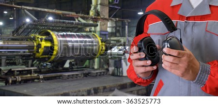 Worker with protective headphone - stock photo