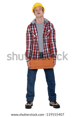 Worker with roof tiles - stock photo