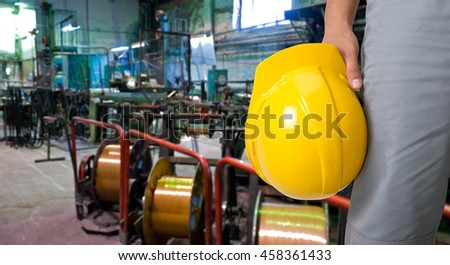 Worker with safety helmet at industrial factory - stock photo