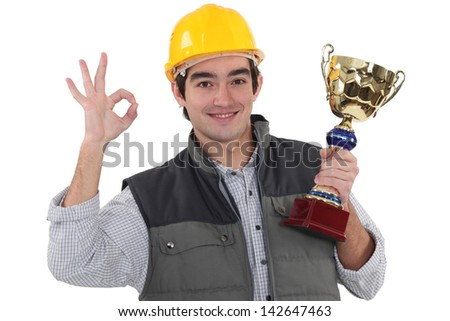 Worker with sports drink - stock photo