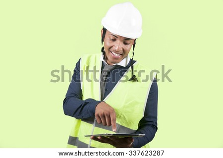 Worker with tablet on green background - stock photo
