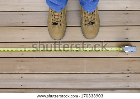 Worker with Tape Measure - stock photo