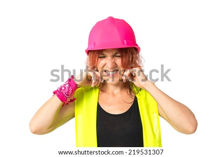 Worker woman covering her ears over white background - stock photo