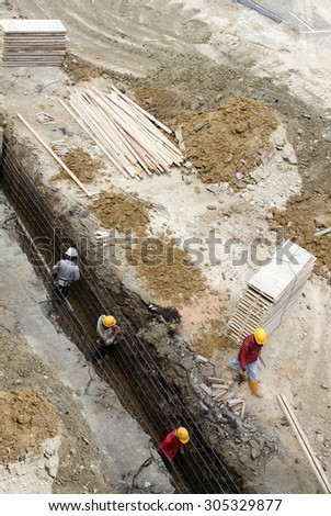 Workers at a building construction site  - stock photo