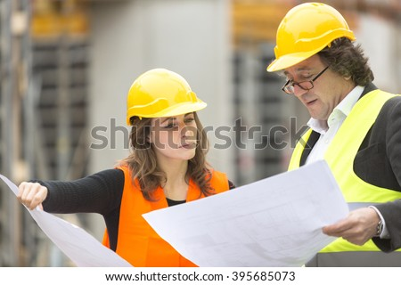 Workers at the construction site - stock photo