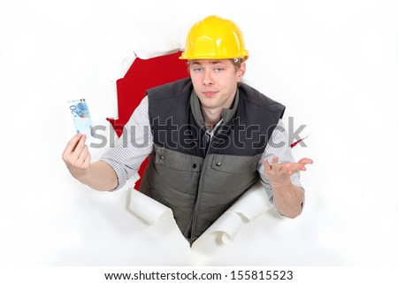 Workers coming out of torn paper hole with ticket in hand - stock photo