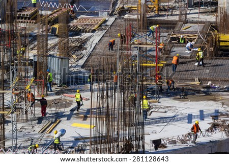 Workers construction of a new building in Almaty - stock photo
