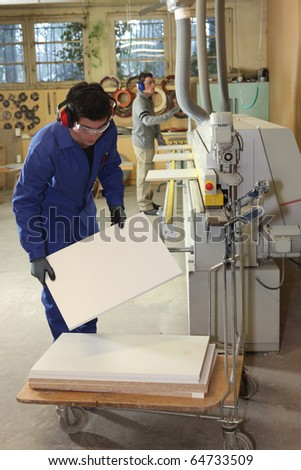 Workers in carpentry workshop - stock photo