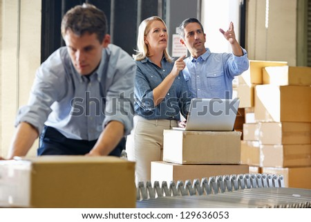 Workers In Distribution Warehouse - stock photo
