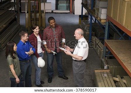 Workers in warehouse - stock photo
