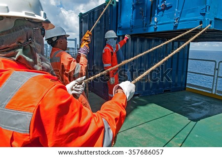 workers on duty at Offshore construction platform for production oil and gas, Aerial view. - stock photo